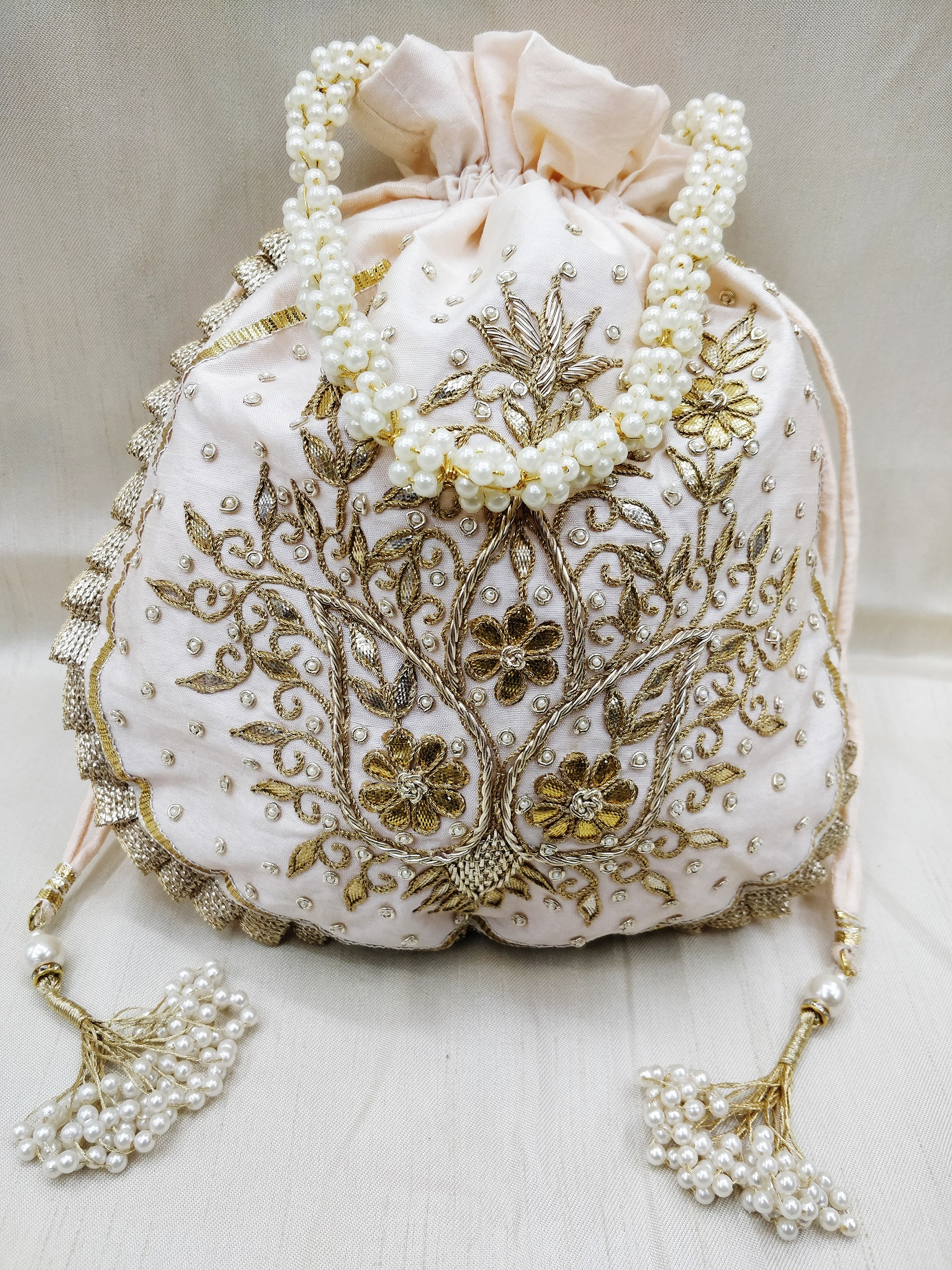 Golden gota patti & zardosi embroidered floral texture indian wedding potli bag handbag for women | peach silk fabric bridesmaid handbag