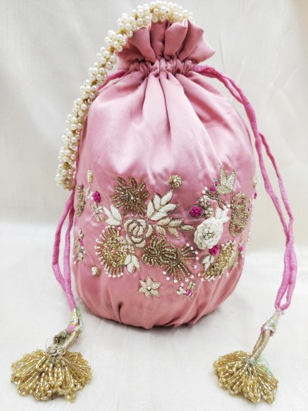 Artisian handmade floral texture zardosi & thread embroidered solomon pink potli bag | wedding fabric handbag handmade with accessory
