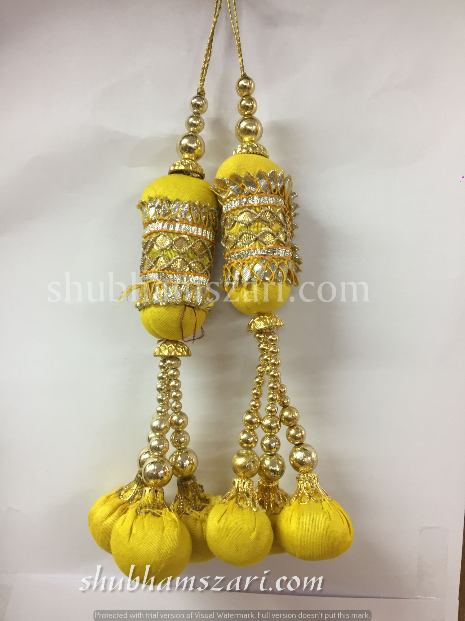 Shubhams yellow colour pillow Latkan For embellish saris Blouse lehengas and kurtie