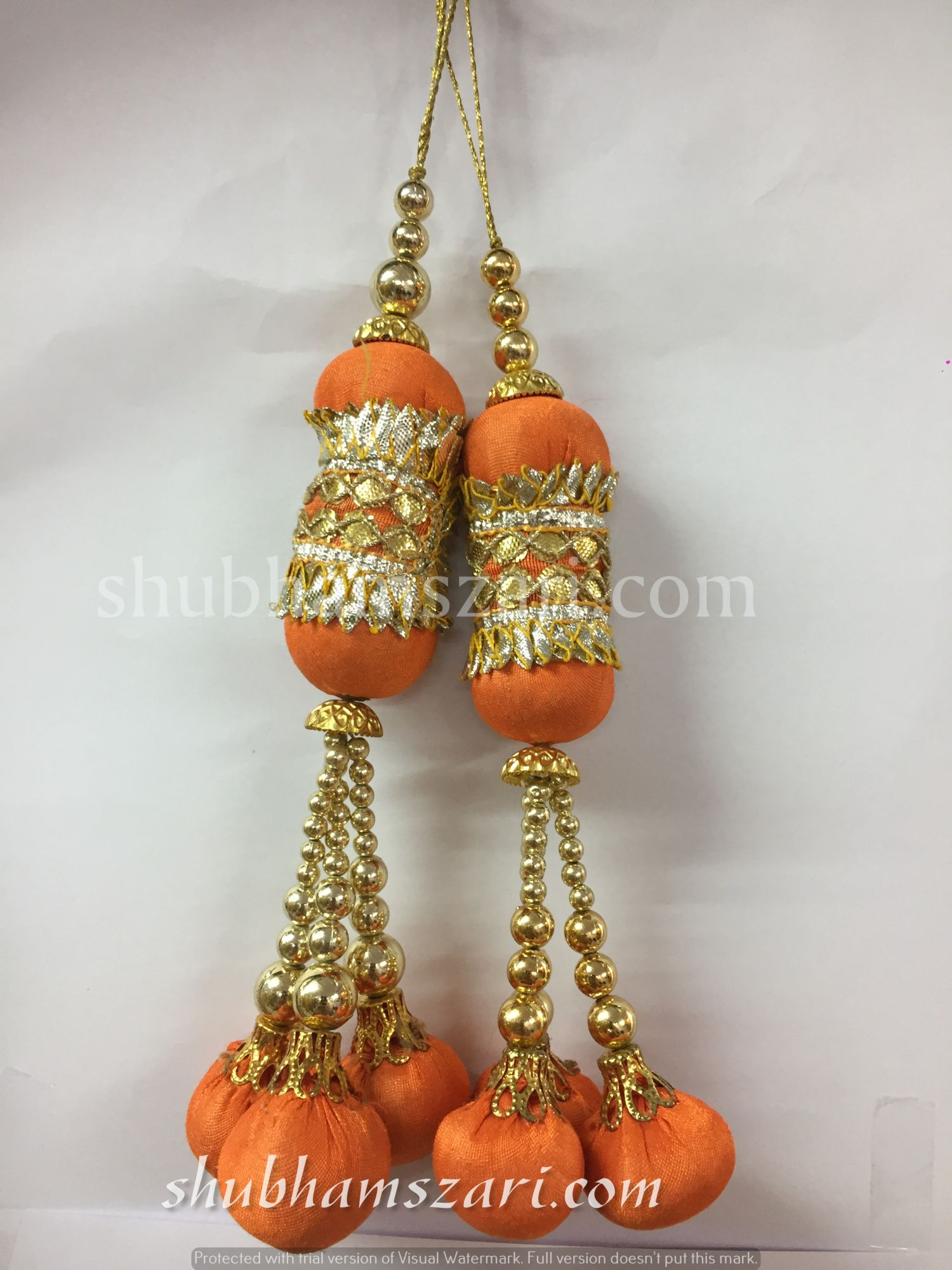 Shubhams orange colour pillow Latkan For embellish saris Blouse lehengas and kurtie
