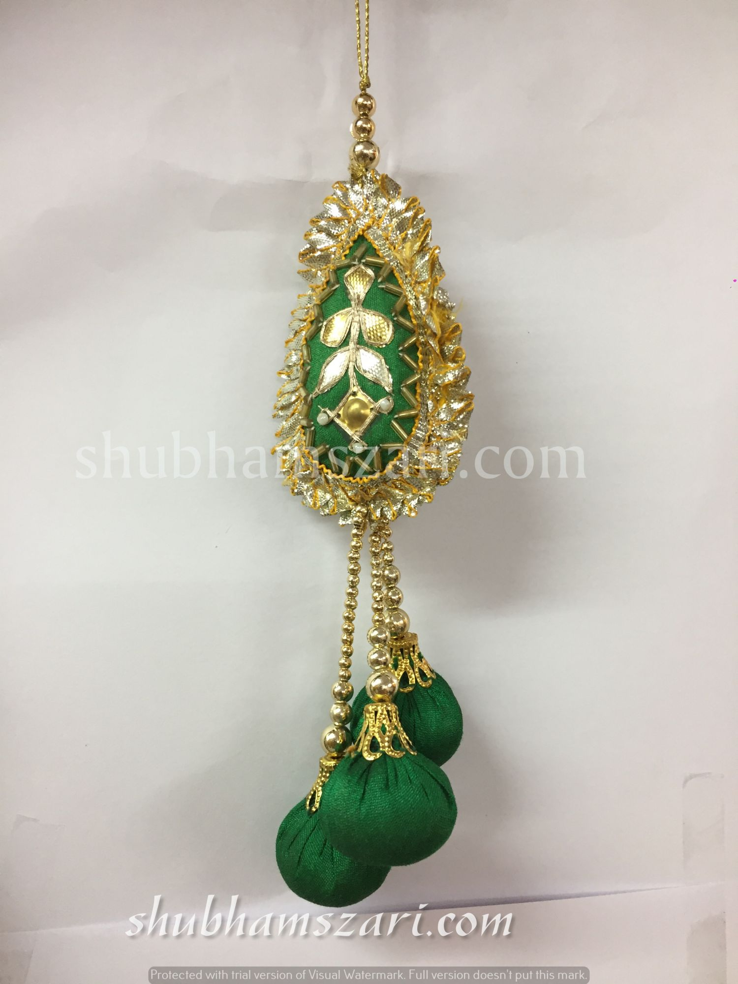 Shubhams green colour tilak  shape gota patti work