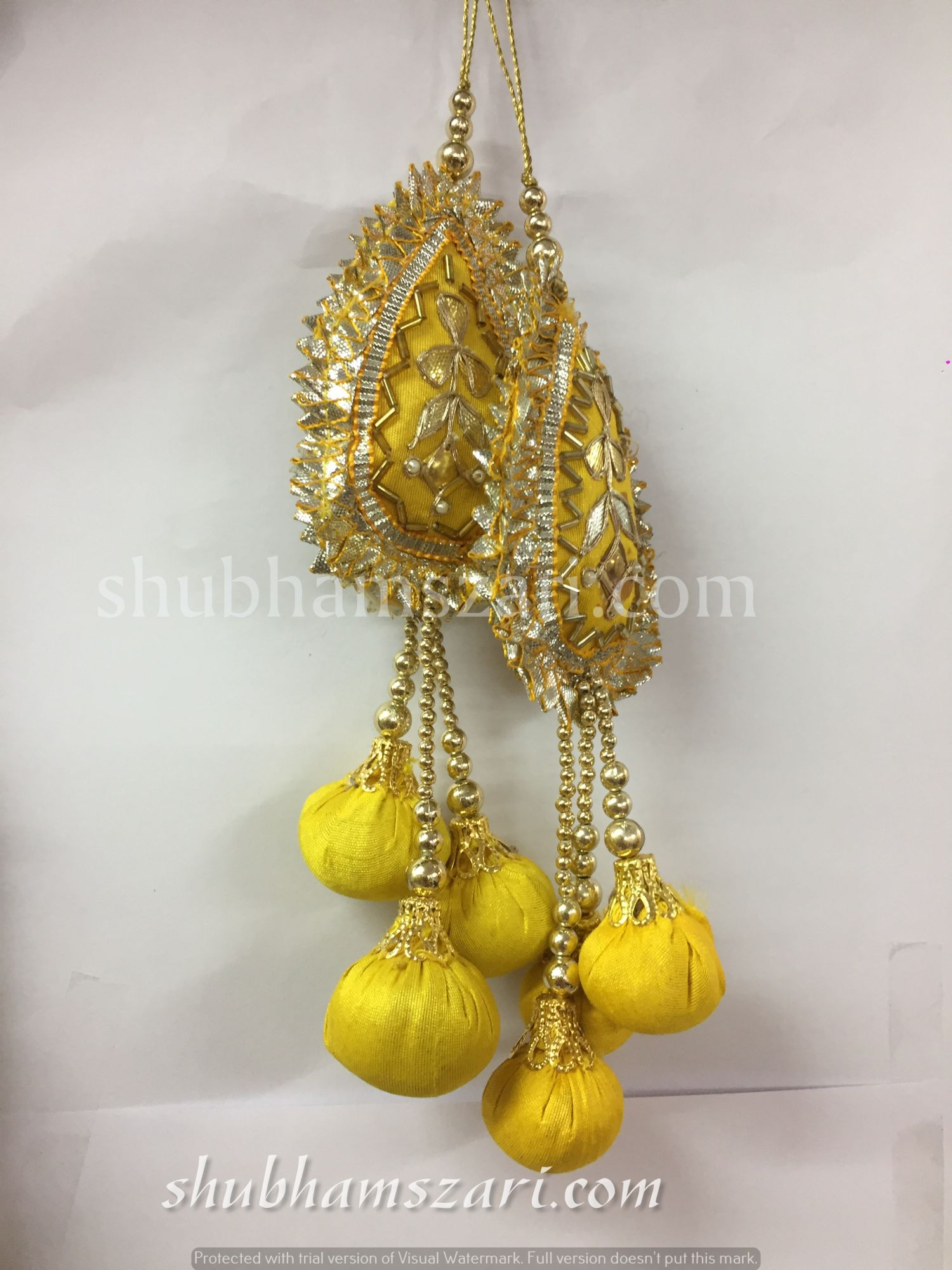 Shubhams yellow colour tilak  shape gota patti work