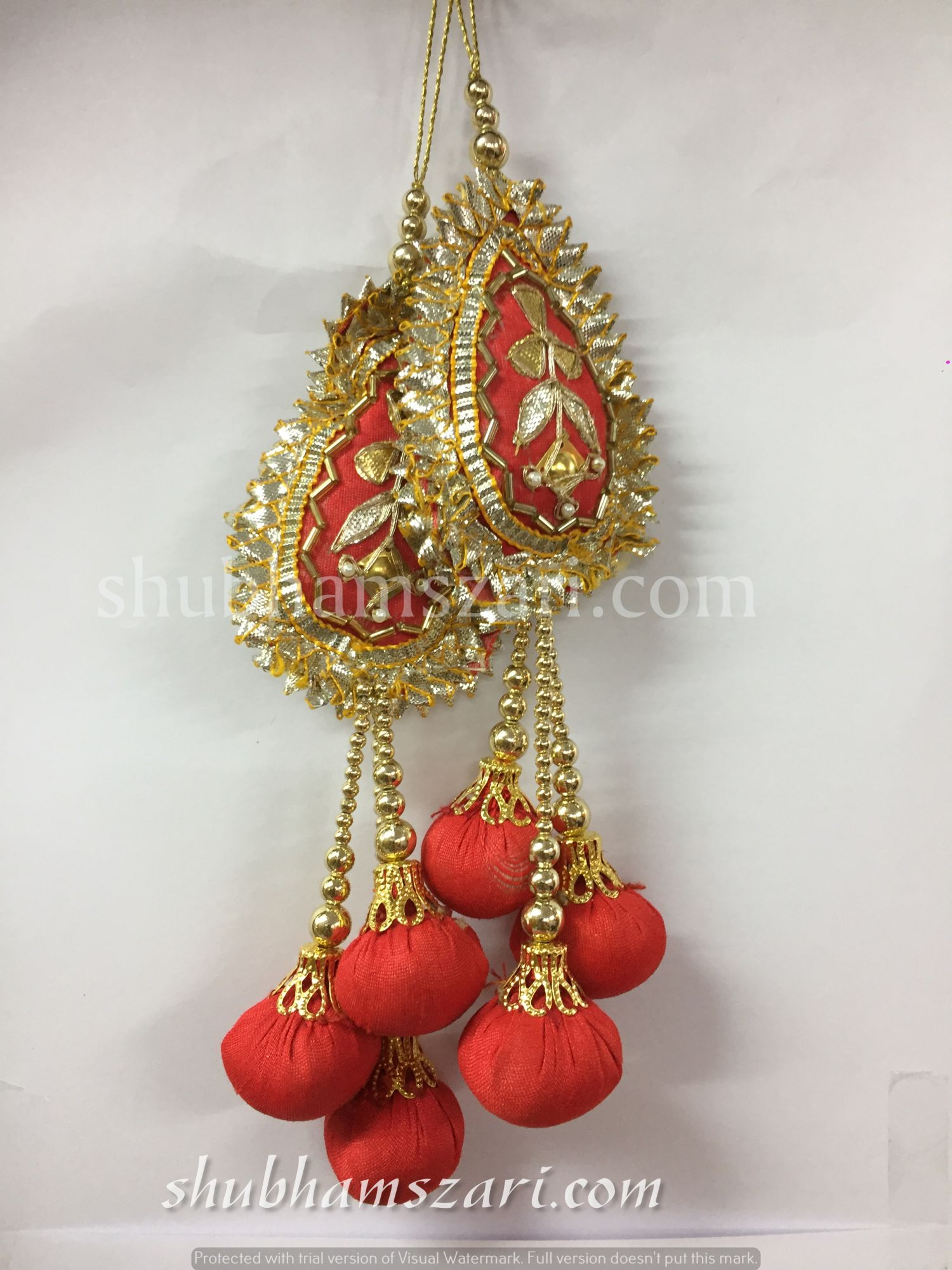 Shubhams red colour tilak  shape gota patti work