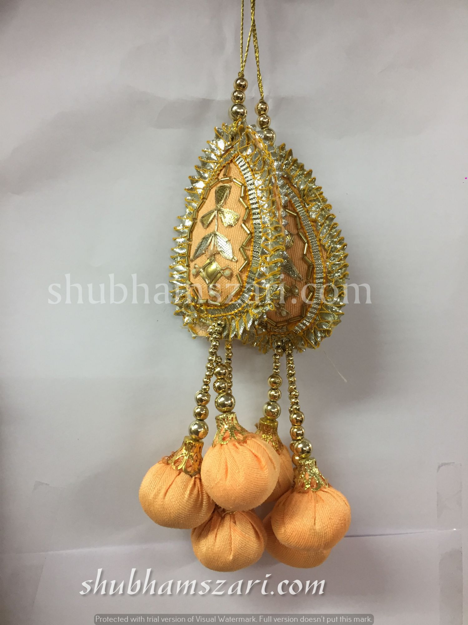 Shubhams peach colour tilak  shape gota patti work