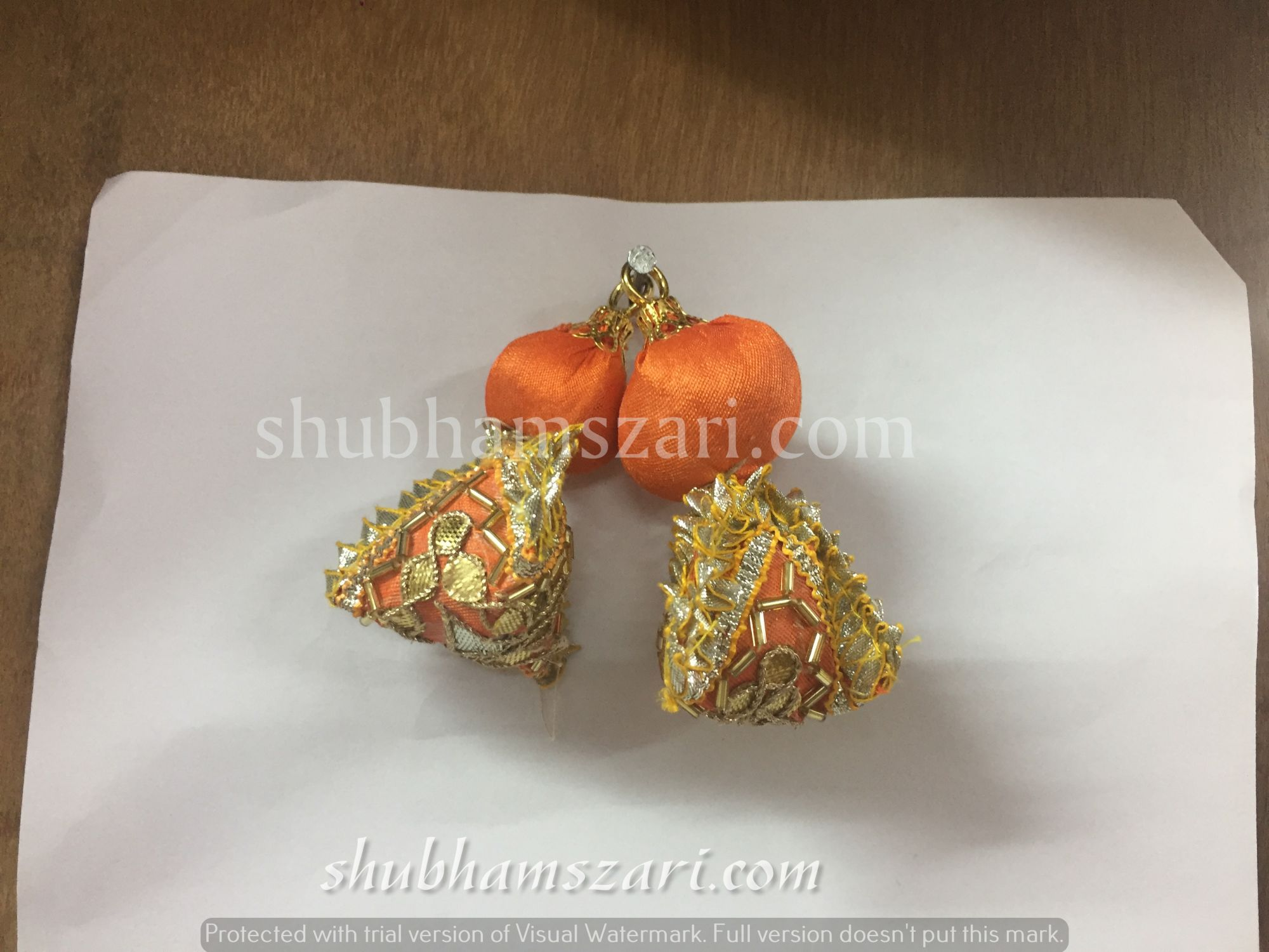 Shubhams small orange colour samosa shape gotta patti work latkan