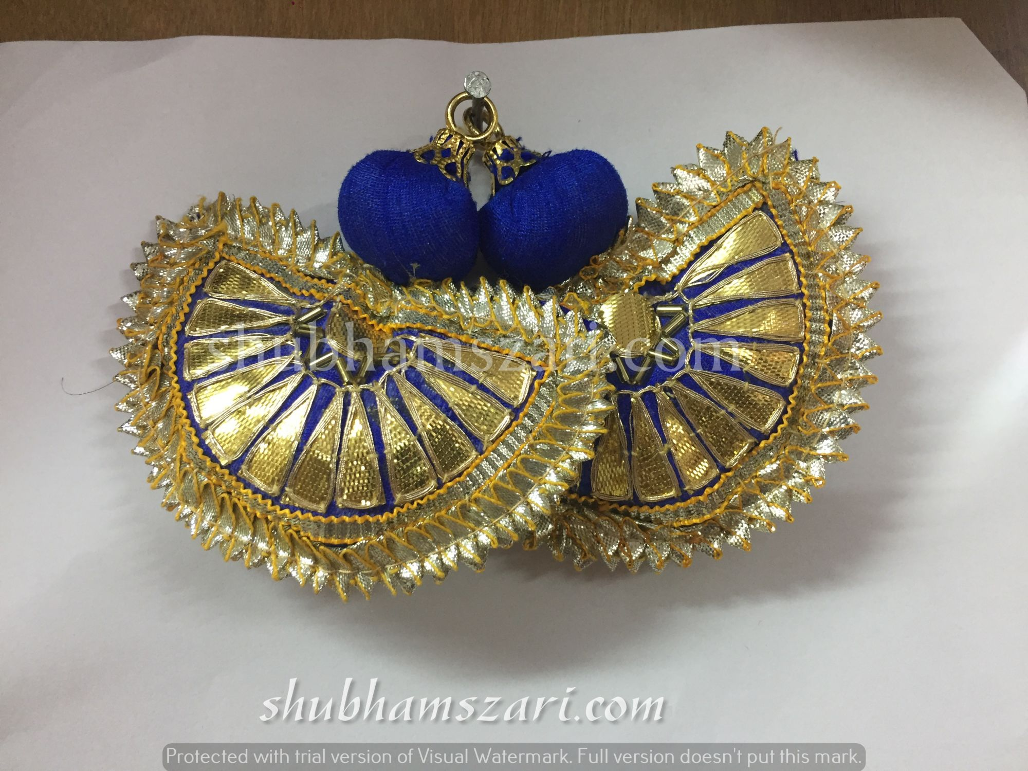 Shubhams small blue colour half chand shape gotta patti work latkan