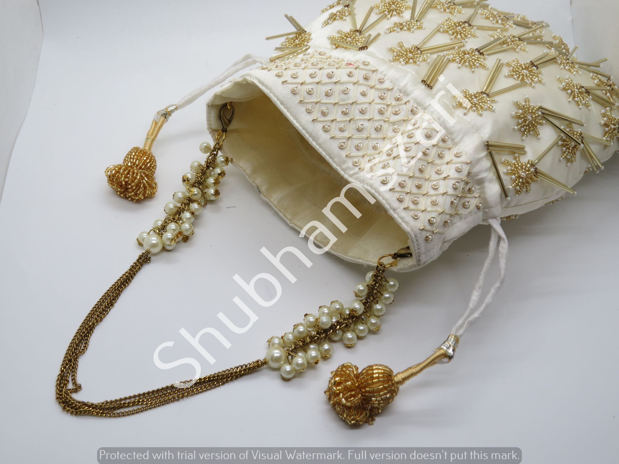 Ivory Silk, Katdana Beads, potli bag, tassels, handcrafted, handmade, designer luxury handbag, wedding potli, party bag,