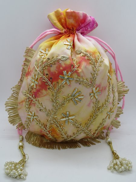 Featuring a silk shibori handcrafted polti bag silk drawstring handbag  with gota zardozi handmade potli bag